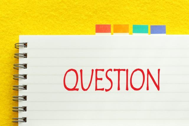 Questionの文字が書かれたノート 画像